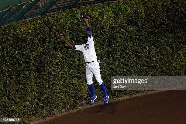 Dexter Fowler of the Chicago Cubs catches a pop up fly hit by Yoenis Cespedes of the New York Mets in the third inning during game three of the 2015...