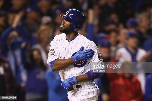 Dexter Fowler of the Chicago Cubs celebrates after hitting a home run in the eighth inning against the Cleveland Indians in Game Four of the 2016...