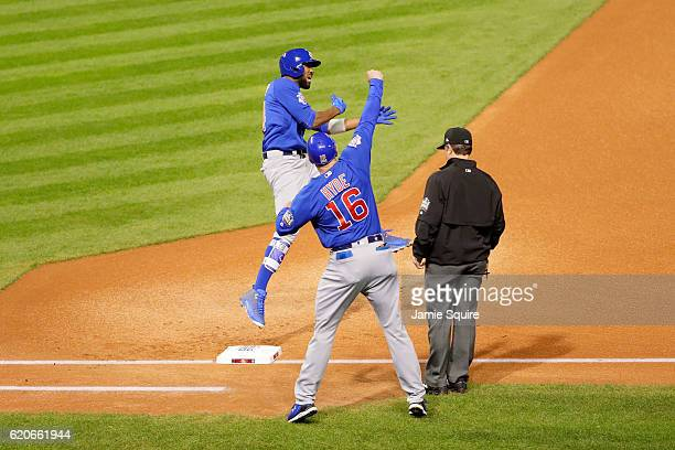 Dexter Fowler of the Chicago Cubs celebrates with first base coach Brandon Hyde after hitting a lead off home run in the first inning against the...