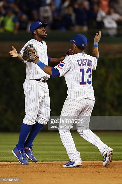 Dexter Fowler of the Chicago Cubs celebrates with Starlin Castro of the Chicago Cubs after defeating the St Louis Cardinals in game three of the...