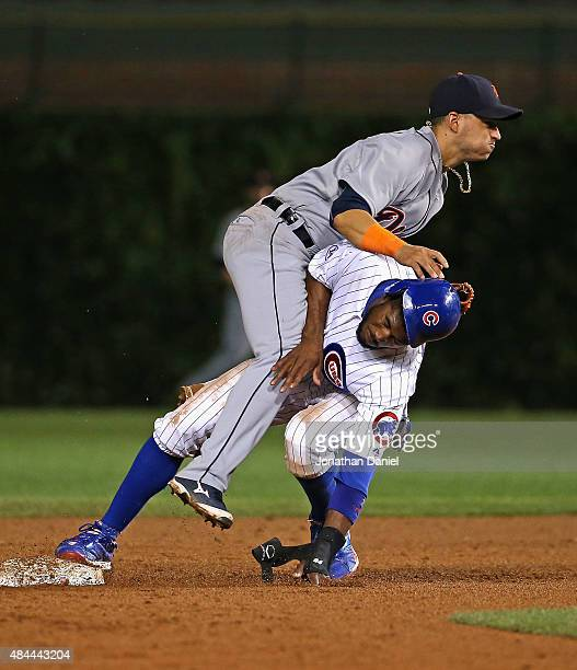 Dexter Fowler of the Chicago Cubs collides with Jose Iglesias of the Detroit Tigers as Iglesias tries to turn a double play in the 9th inning at...