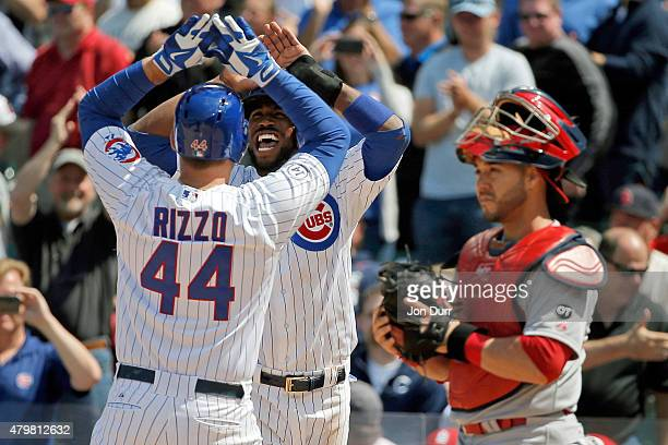Dexter Fowler of the Chicago Cubs congratulates Anthony Rizzo after he hit a two run home run against the St Louis Cardinals during the eighth inning...