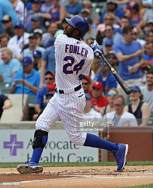 Dexter Fowler of the Chicago Cubs hits a leadoff solo home run in the 1st inning against the Philadelphia Phillies at Wrigley Field on May 28 2016 in...