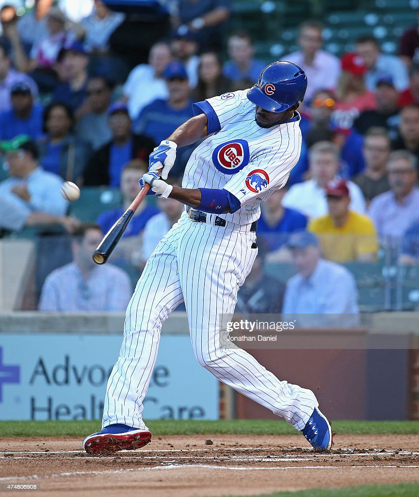 Dexter Fowler #24 of the Chicago Cubs hits a solo home run in the 1st inning against the Washington Nationals at Wrigley Field on May 26, 2015 in Chicago, Illinois.