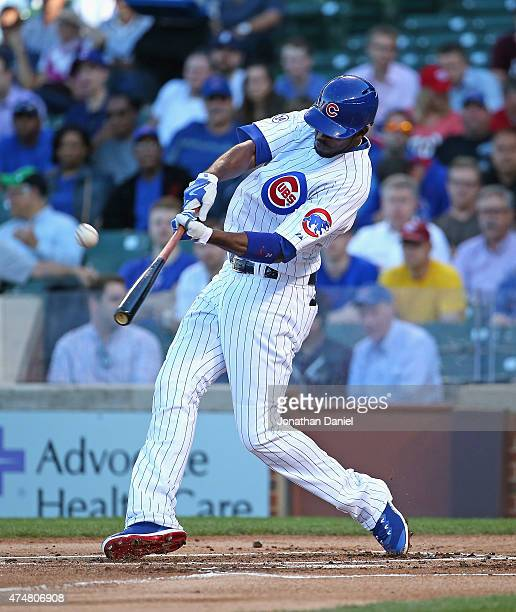 Dexter Fowler of the Chicago Cubs hits a solo home run in the 1st inning against the Washington Nationals at Wrigley Field on May 26 2015 in Chicago...