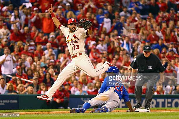Dexter Fowler of the Chicago Cubs is safe at third base after Matt Carpenter of the St Louis Cardinals attempts to force him out in the seventh...