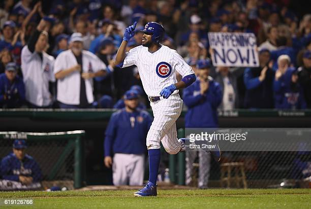 Dexter Fowler of the Chicago Cubs rounds the bases after hitting a home run in the eighth inning against the Cleveland Indians in Game Four of the...