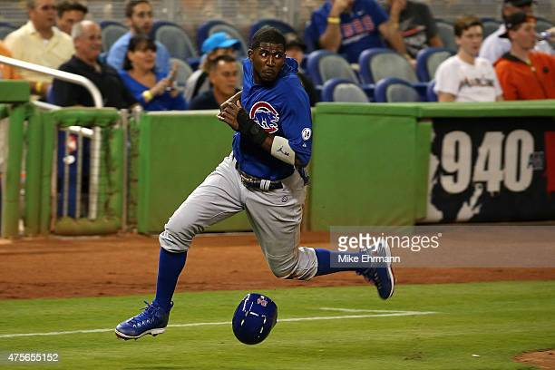 Dexter Fowler of the Chicago Cubs scores a run during a game against the Miami Marlins at Marlins Park on June 2 2015 in Miami Florida