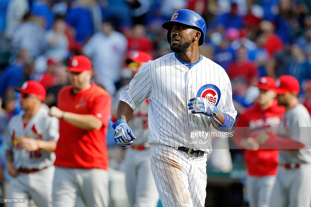 Dexter Fowler #24 of the Chicago Cubs watches the replay after flying out for the final out of the game in their loss to the St. Louis Cardinals at Wrigley Field on September 24, 2016 in Chicago, Illinois. The St. Louis Cardinals won 10-4.