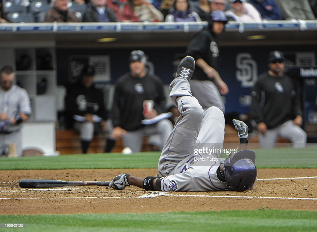 Dexter Fowler #24 of the Colorado Rockies falls after being brushed back by a pitch during the third inning of a baseball game against the San Diego Padres at Petco Park on April 14, 2013 in San Diego, California.