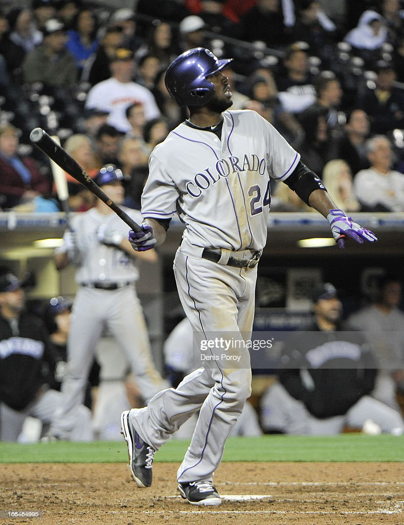 Dexter Fowler #24 of the Colorado Rockies hits a solo home run in the ninth inning against the San Diego Padres at Petco Park on April 12, 2013 in San Diego, California. The Rockies won 7-5.