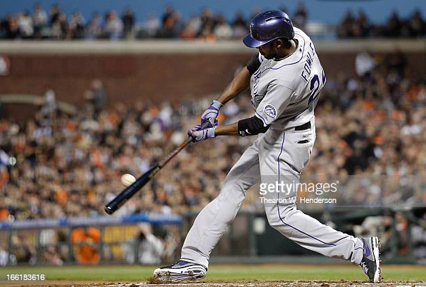 Dexter Fowler of the Colorado Rockies hits a two run double against the San Francisco Giants in the second inning at ATT Park on April 9 2013 in San...
