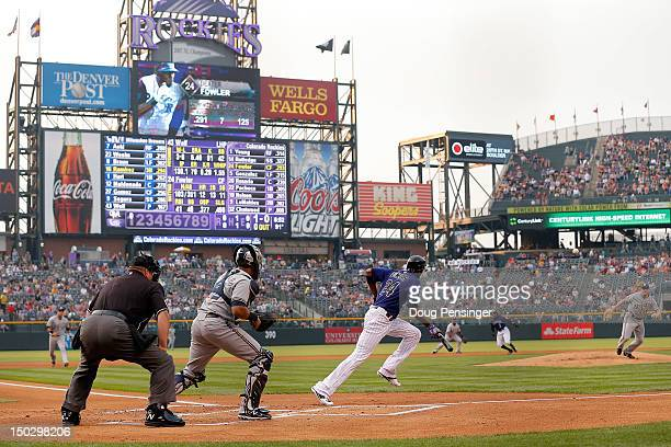 Dexter Fowler of the Colorado Rockies lays down a sacrifice bunt against Randy Wolf of the Milwaukee Brewers at Coors Field on August 14 2012 in...
