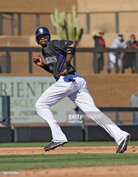 Dexter Fowler of the Colorado Rockies runs the bases against the Texas Rangers during a spring training game at Salt River Field on February 25 2013...