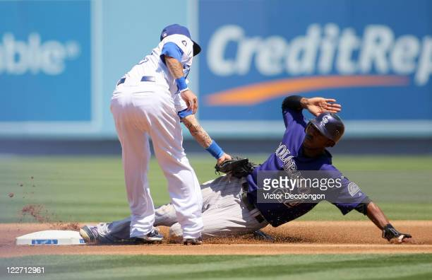 Dexter Fowler of the Colorado Rockies steals second base under the tag of second baseman Justin Sellers of the Los Angeles Dodgers in the first...