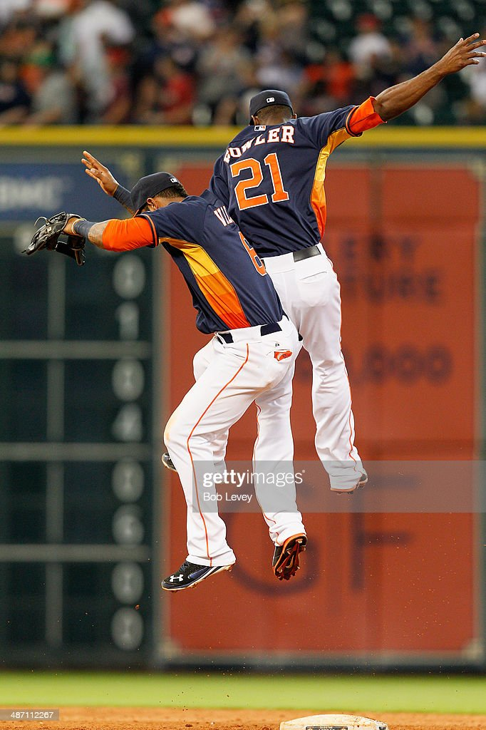 Dexter Fowler #21 of the Houston Astros and Jonathan Villar #6 celebrate afte the final out as the Houston Astros defeated the Oakland Athletics 5-1 at Minute Maid Park on April 27, 2014 in Houston, Texas.