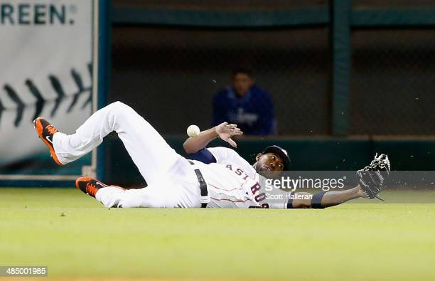 Dexter Fowler of the Houston Astros dives for a ball in center field in the sixth inning against the Kansas City Royals at Minute Maid Park on April...