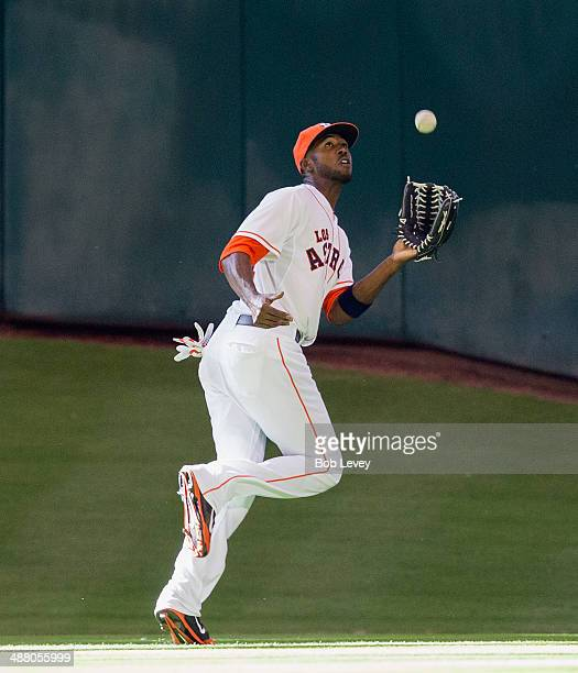 Dexter Fowler of the Houston Astros makes a catch on a fly ball hit by Cole Gillespie of the Seattle Mariners at Minute Maid Park on May 3 2014 in...