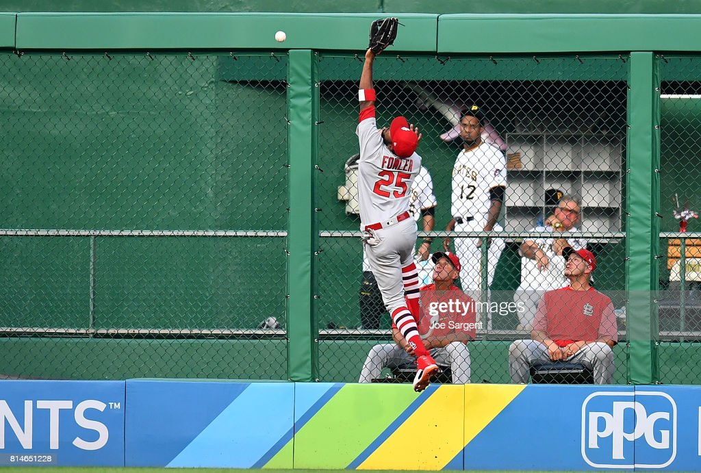 Dexter Fowler #25 of the St. Louis Cardinals can't make a catch on a ball hit by Gregory Polanco #25 of the Pittsburgh Pirates (not pictured) during the fourth inning at PNC Park on July 14, 2017 in Pittsburgh, Pennsylvania.
