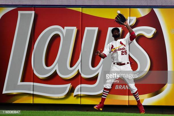 Dexter Fowler of the St Louis Cardinals catches a fly ball at the wall during the seventh inning against the Milwaukee Brewers at Busch Stadium on...