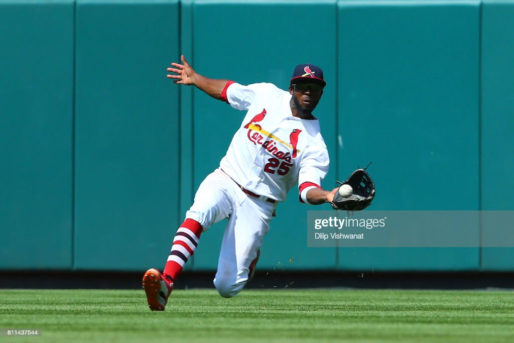 Dexter Fowler #25 of the St. Louis Cardinals catches a line drive against the New York Mets in the ninth inning at Busch Stadium on July 9, 2017 in St. Louis, Missouri.