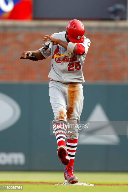 Dexter Fowler of the St Louis Cardinals celebrates after hitting a twoRBI double against the Atlanta Braves during the first inning in game five of...