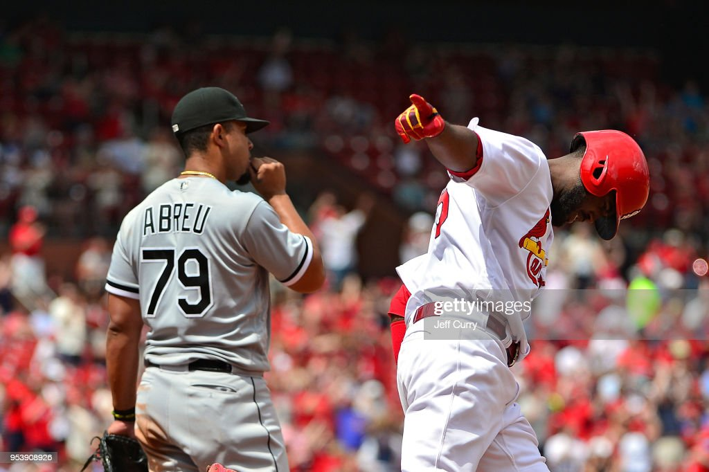 Dexter Fowler #25 of the St. Louis Cardinals celebrates as he runs past Jose Abreu #79 of the Chicago White Sox after hitting a two run home run during the seventh inning at Busch Stadium on May 2, 2018 in St Louis, Missouri.