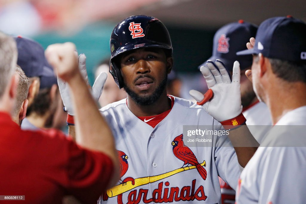 Dexter Fowler #25 of the St. Louis Cardinals celebrates in the dugout after hitting a two-run home run in the third inning of a game against the Cincinnati Reds at Great American Ball Park on September 20, 2017 in Cincinnati, Ohio.