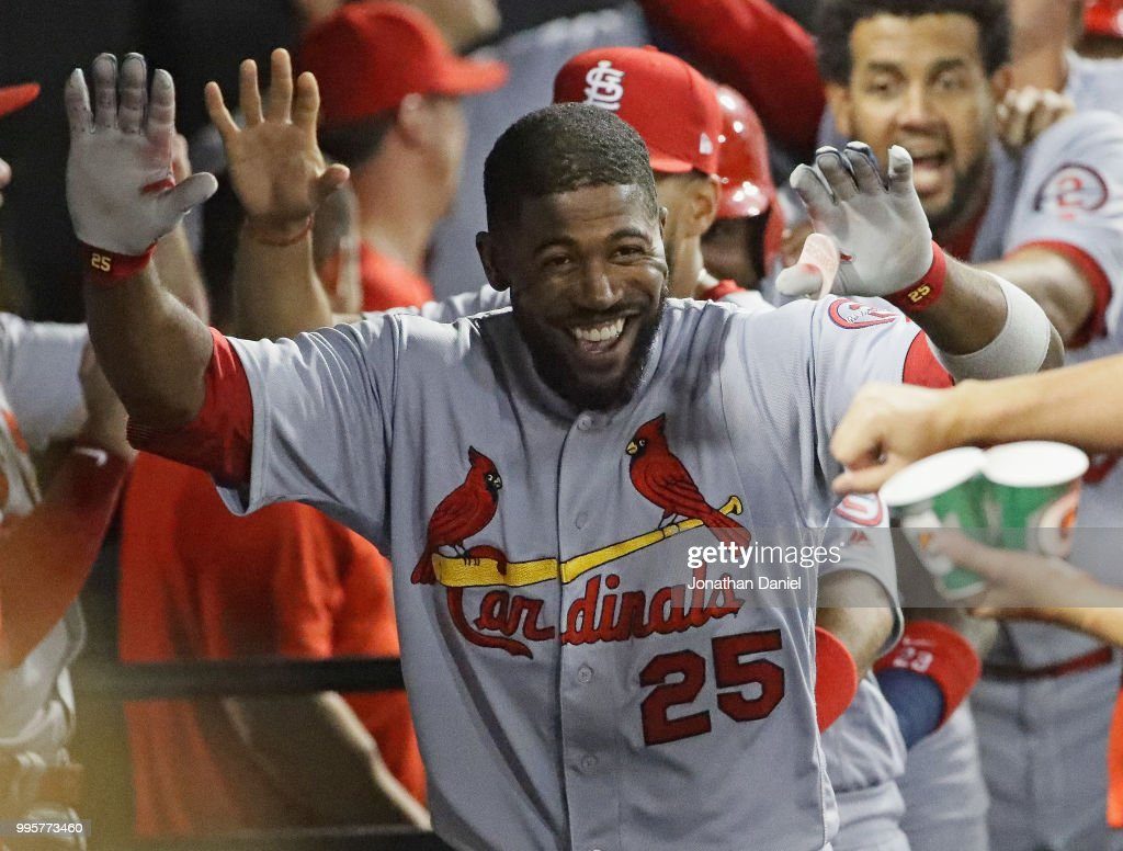 Dexter Fowler #25 of the St. Louis Cardinals celebrates in the dugout after hitting a grand slam home run in the 6th inning against the Chicago White Sox at Guaranteed Rate Field on July 10, 2018 in Chicago, Illinois.