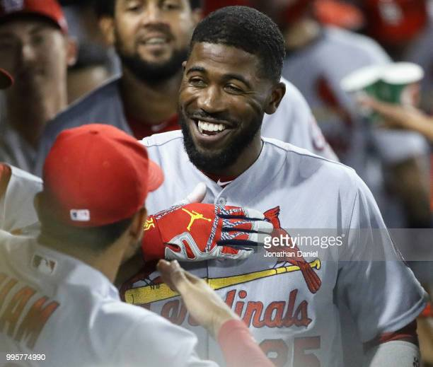 Dexter Fowler of the St Louis Cardinals celebrates in the dugout after hitting a grand slam home run in the 6th inning against the Chicago White Sox...