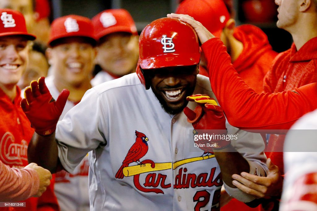 Dexter Fowler #25 of the St. Louis Cardinals celebrates with teammates after hitting a home run in the first inning against the Milwaukee Brewers at Miller Park on April 3, 2018 in Milwaukee, Wisconsin.