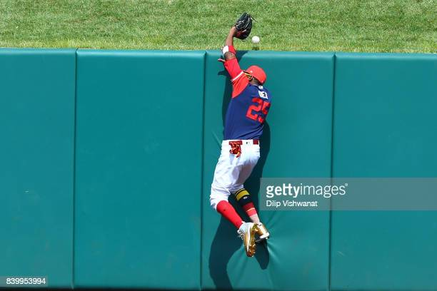 Dexter Fowler of the St Louis Cardinals fails to catch a home run against the Tampa Bay Rays in the seventh inning at Busch Stadium on August 27 2017...