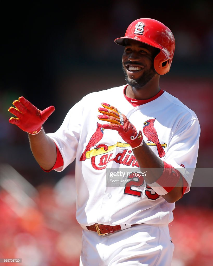 Dexter Fowler #25 of the St. Louis Cardinals gestures toward the dugout after hitting a RBI single during the fifth inning against the Milwaukee Brewers at Busch Stadium on June 13, 2017 in St. Louis, Missouri.