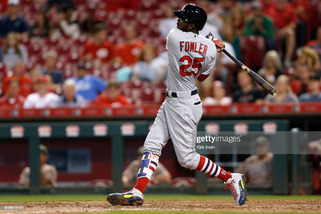 Dexter Fowler #25 of the St. Louis Cardinals hits a home run to tie the game against the St. Louis Cardinals during the eighth inning of the game at Great American Ball Park on September 19, 2017 in Cincinnati, Ohio. St. Louis defeated Cincinnati 8-7 in ten innings.