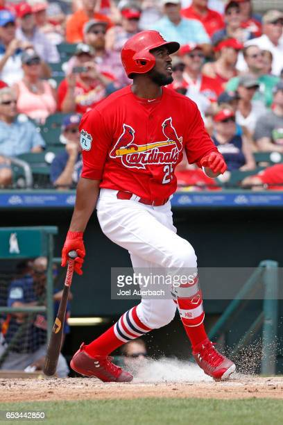 Dexter Fowler of the St Louis Cardinals hits the ball against of the Houston Astros in the third inning during a spring training game at Roger Dean...