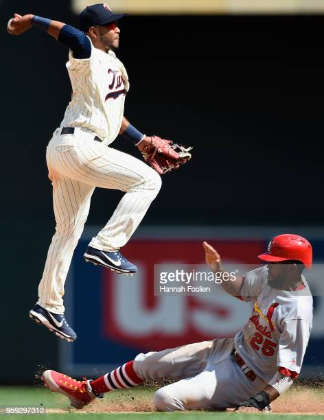 Dexter Fowler of the St Louis Cardinals is out at second base as Gregorio Petit of the Minnesota Twins turns a double play during the ninth inning of...