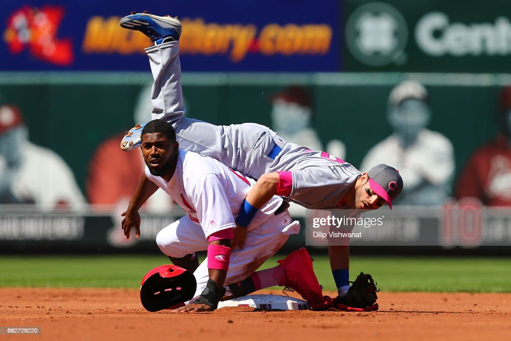 Dexter Fowler #25 of the St. Louis Cardinals is out in a double play against Tommy La Stella #2 of the Chicago Cubs in the first inning at Busch Stadium on May 13, 2017 in St. Louis, Missouri. Players are wearing pink to celebrate Mother's Day weekend and support breast cancer awareness.