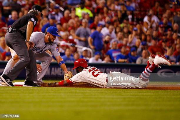 Dexter Fowler of the St Louis Cardinals is thrown out at third base against Kris Bryant of the Chicago Cubs in the sixth inning at Busch Stadium on...
