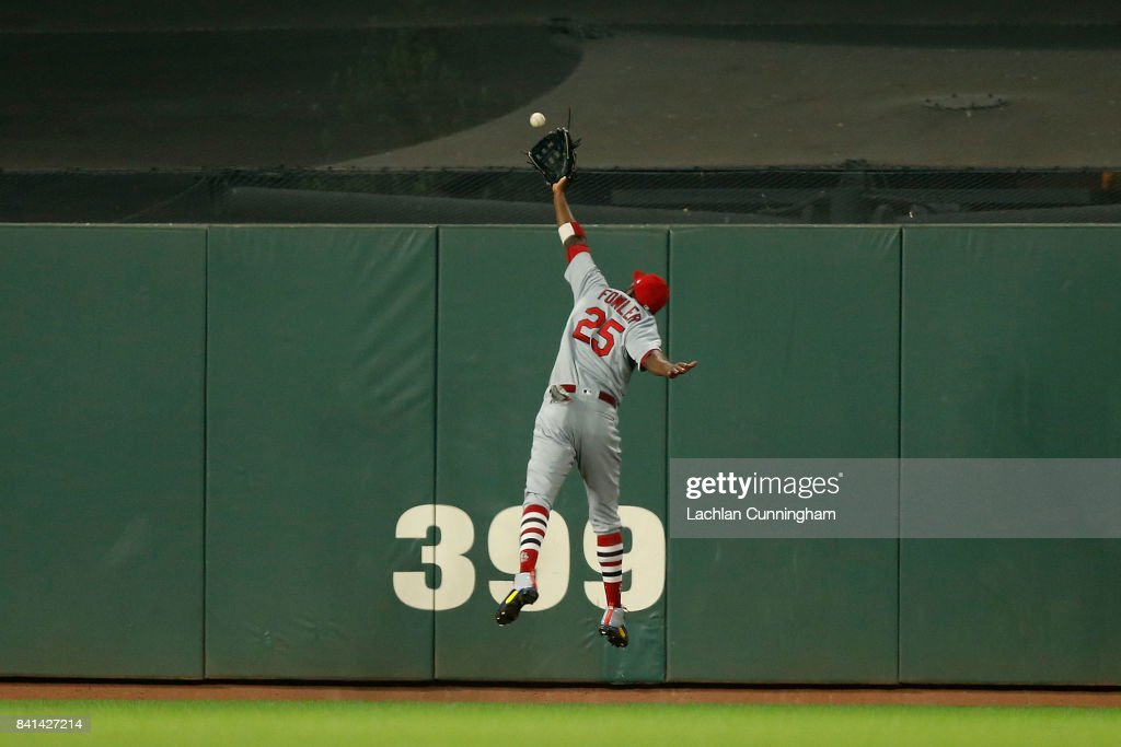 Dexter Fowler #25 of the St Louis Cardinals is unable to catch a triple hit by Ryder Jones #63 of the San Francisco Giants in the seventh inning at AT&T Park on August 31, 2017 in San Francisco, California.