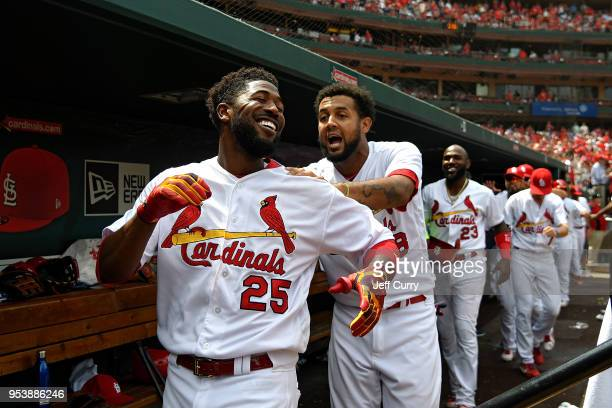 Dexter Fowler of the St Louis Cardinals leads the conga line celebration after hitting a two run home run during the seventh inning against the...