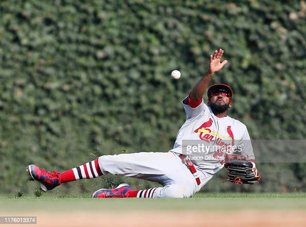 Dexter Fowler of the St Louis Cardinals misses the single by Nico Hoerner of the Chicago Cubs during the seventh inning of a game at Wrigley Field on...
