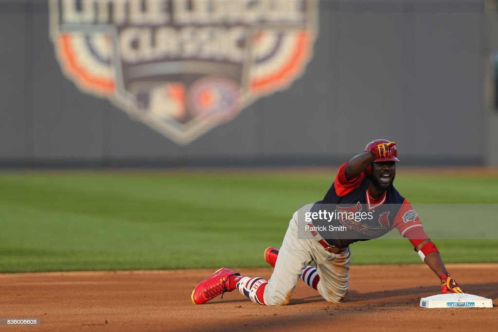 Dexter Fowler #25 of the St. Louis Cardinals reacts after sliding into Josh Harrison #5 of the Pittsburgh Pirates (not pictured) during the first inning in the inaugural MLB Little League Classic at BB&T Ballpark at Historic Bowman Field on August 20, 2017 in Williamsport, Pennsylvania.