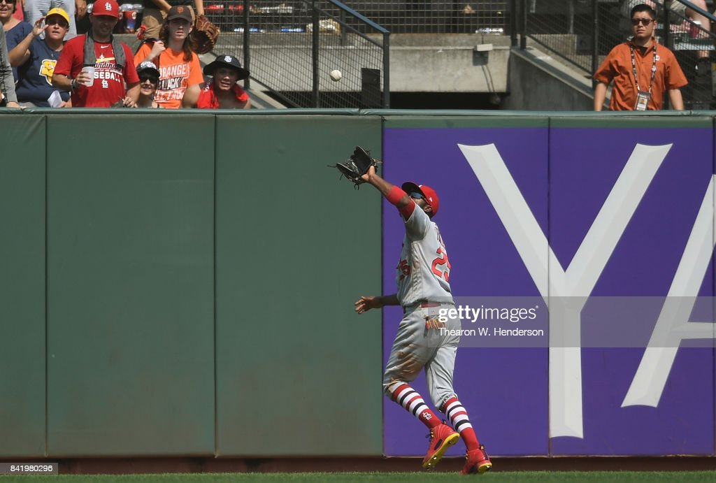Dexter Fowler #25 of the St. Louis Cardinals runs down a fly ball in center field off the bat of Joe Panik #12 of the San Francisco Giants in the bottom of the six inning at AT&T Park on September 2, 2017 in San Francisco, California.