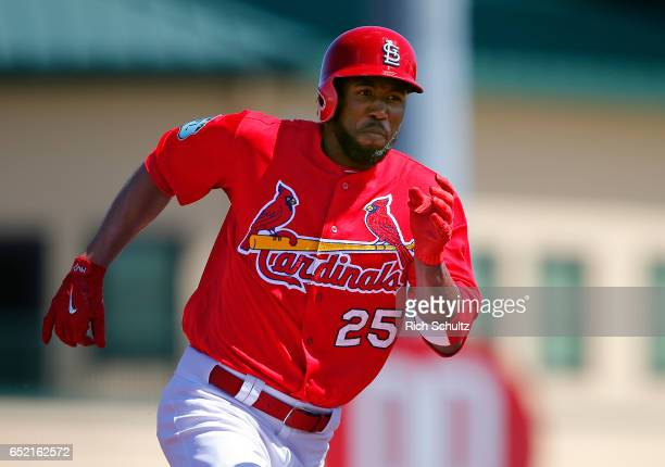 Dexter Fowler of the St Louis Cardinals runs to third base for a triple in the third inning of a spring training baseball game against the Atlanta...