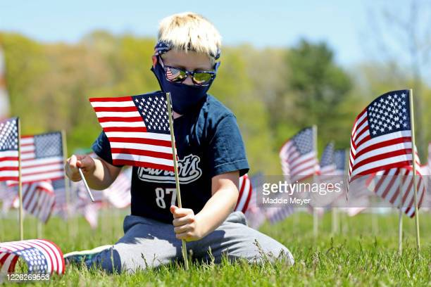 Dexter Griffin of Foxborough plants a flag outside of Gillette Stadium on May 21 2020 in Foxborough Massachusetts The Patriots foundation partnered...