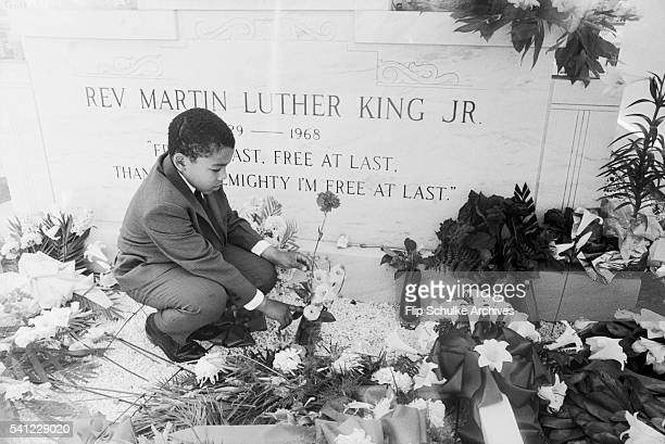 Dexter King visits the grave of his father Martin Luther King Jr one year after his assassination