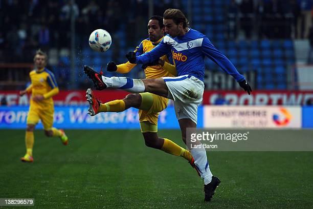 Dexter Langen of Rostock challenges Faton Toski of Bochum during the Second Bundesliga match between VfL Bochum and Hansa Rostock at Rewirpower...