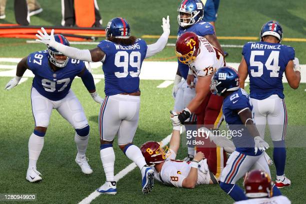 Dexter Lawrence and the New York Giants celebrate after stopping Kyle Allen of the Washington Football Team on a two point conversion attempt in the...