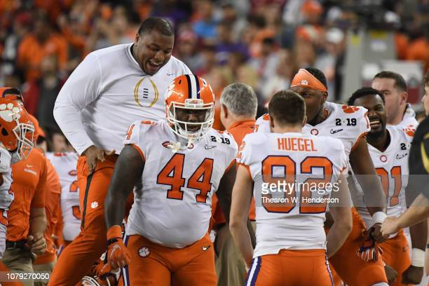Dexter Lawrence of the Clemson Tigers congratulates Nyles Pinckney fourth down tackle on a fake field goal during the second half against the Alabama...