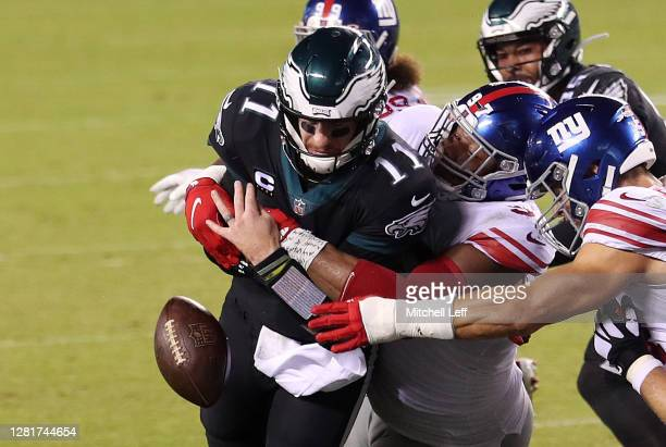 Dexter Lawrence of the New York Giants forces a fumble on Carson Wentz of the Philadelphia Eagles during a two point conversion in the fourth quarter...